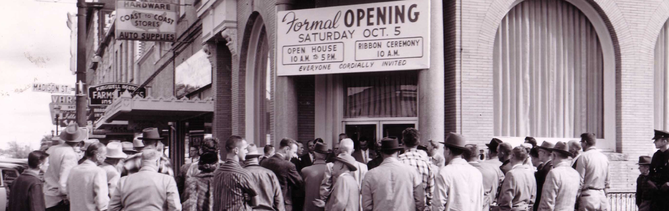 A photo of the formal branch opening with crowd outside building